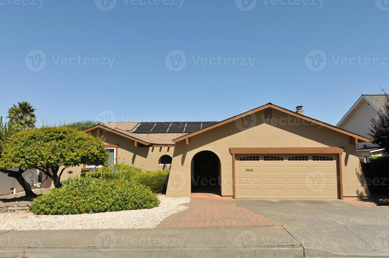 Single story family house with driveway photo