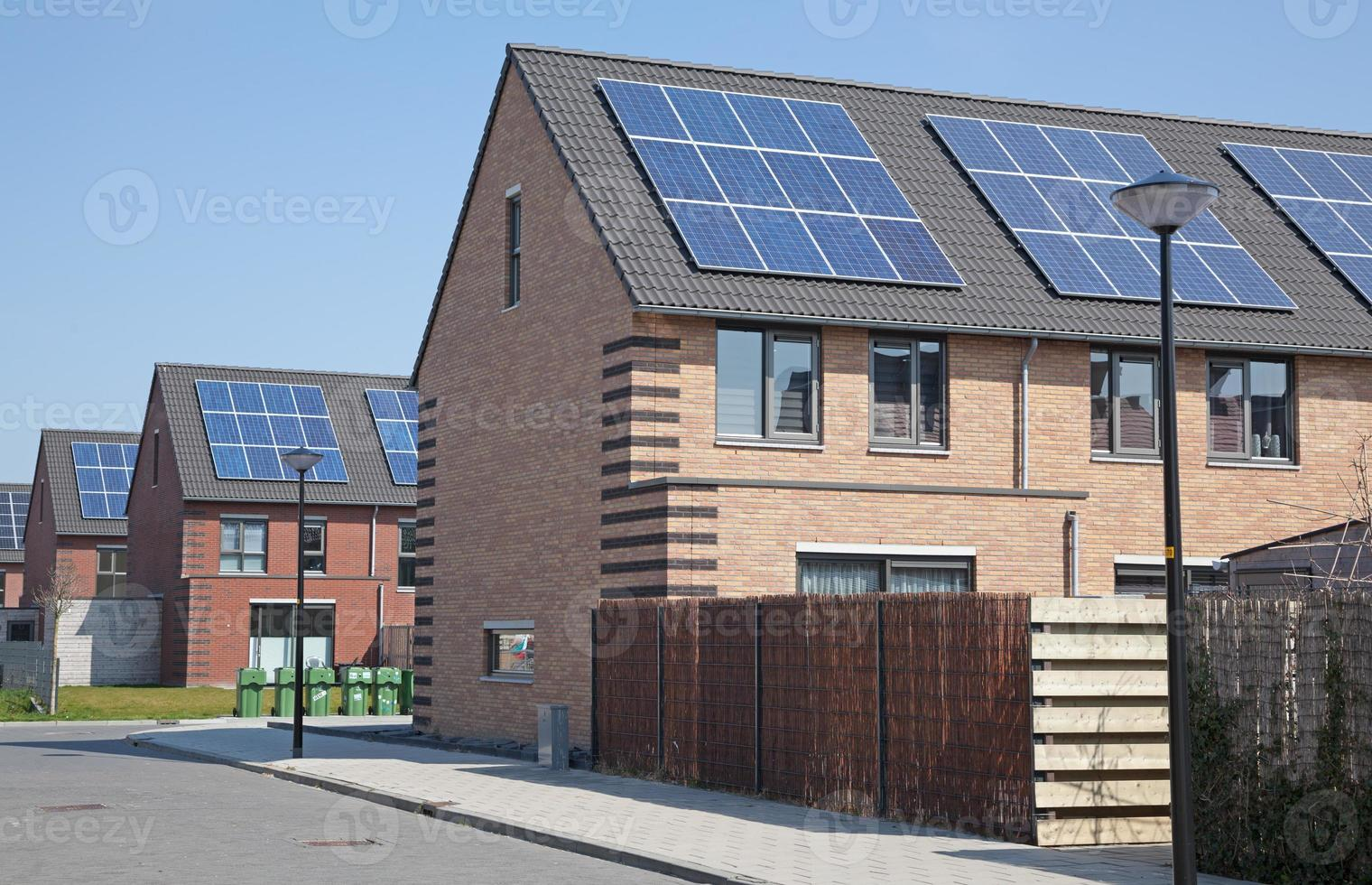 New family homes with solar panels on the roof photo