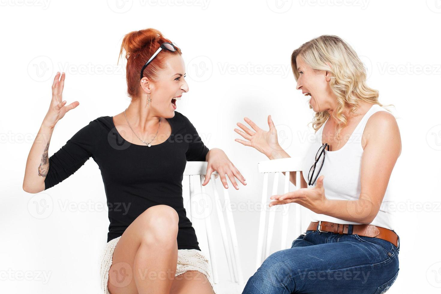 Beautiful adult woman and daughter, brawl, a family quarrel, shouting, photo