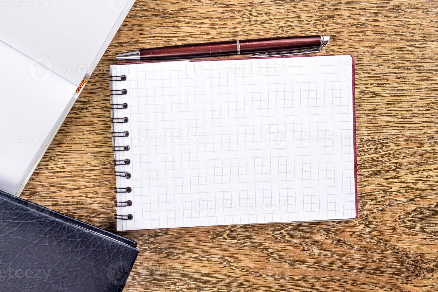 open notebook on desktop background photo