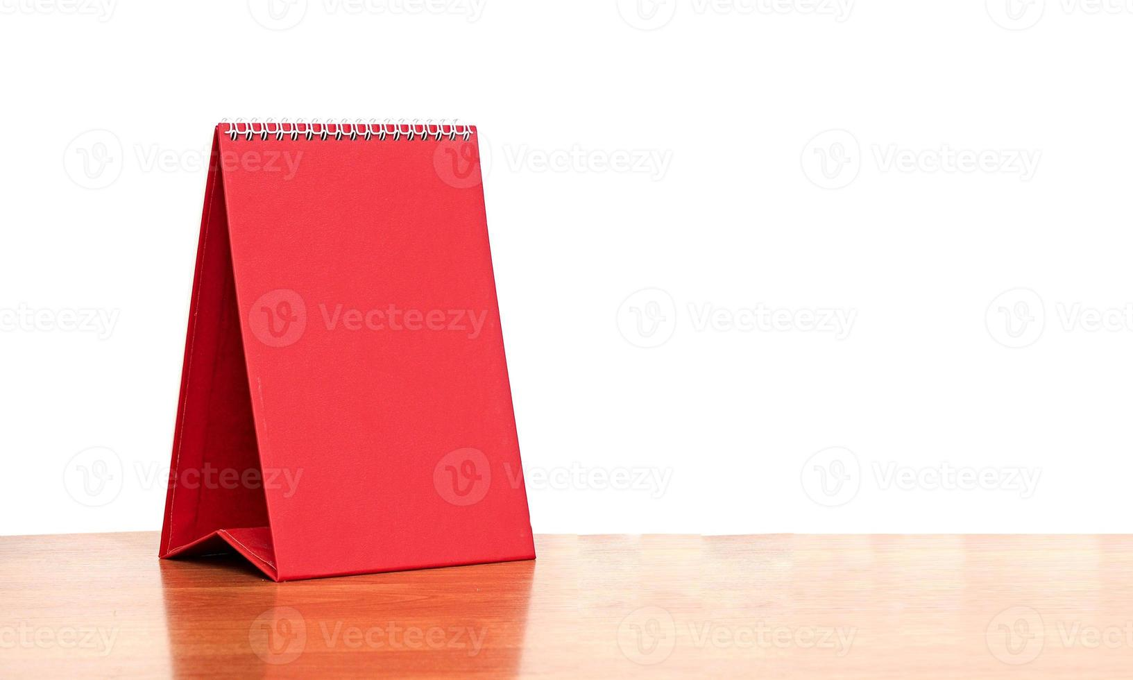 red blank desktop calendar with isolated on white background photo