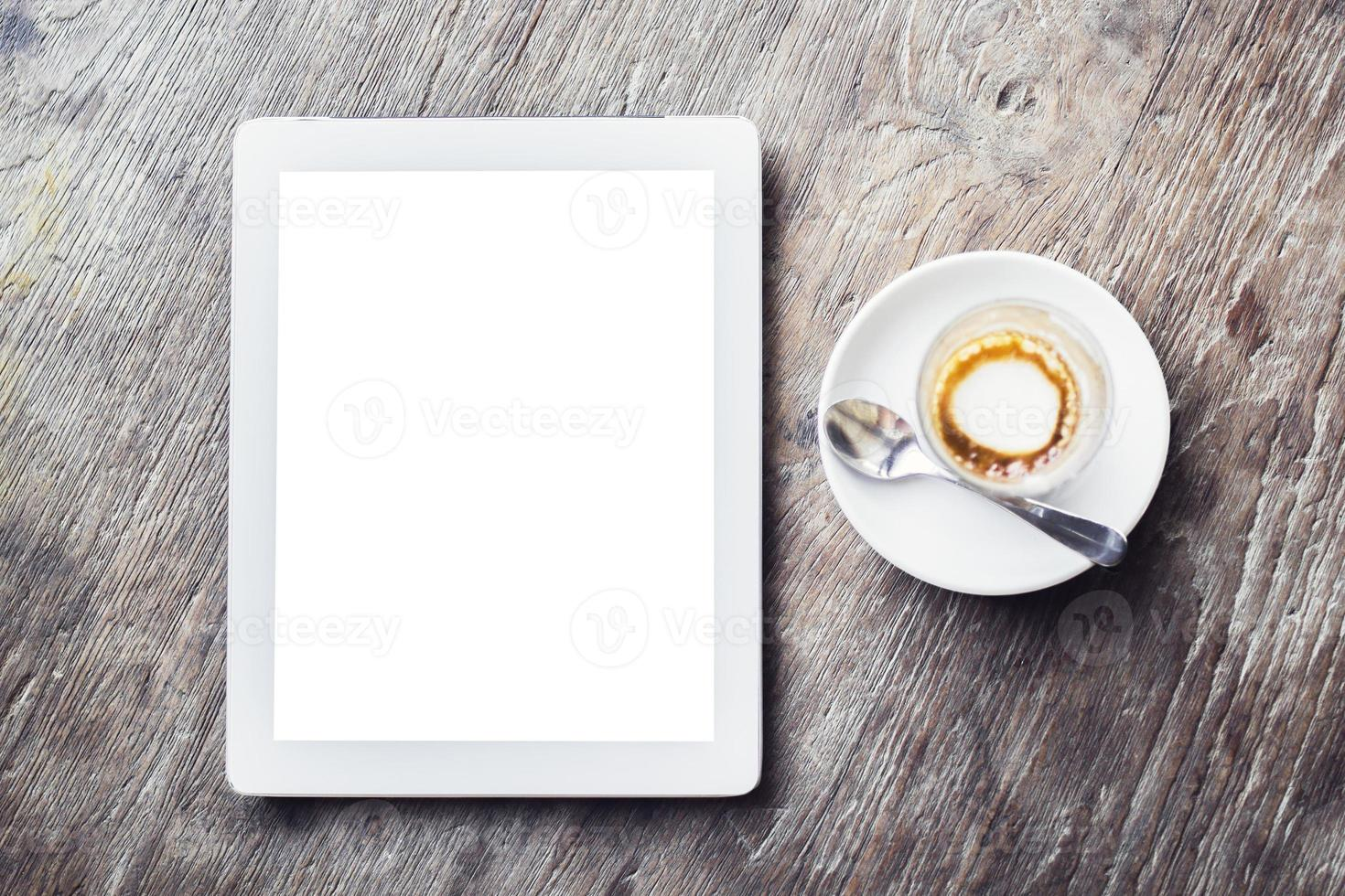 Blank digital tablet with cup of coffee photo