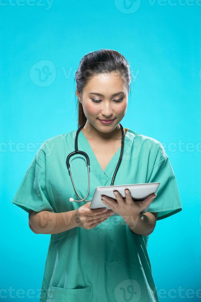 Portrait of a Female doctor holding a digital tablet. photo