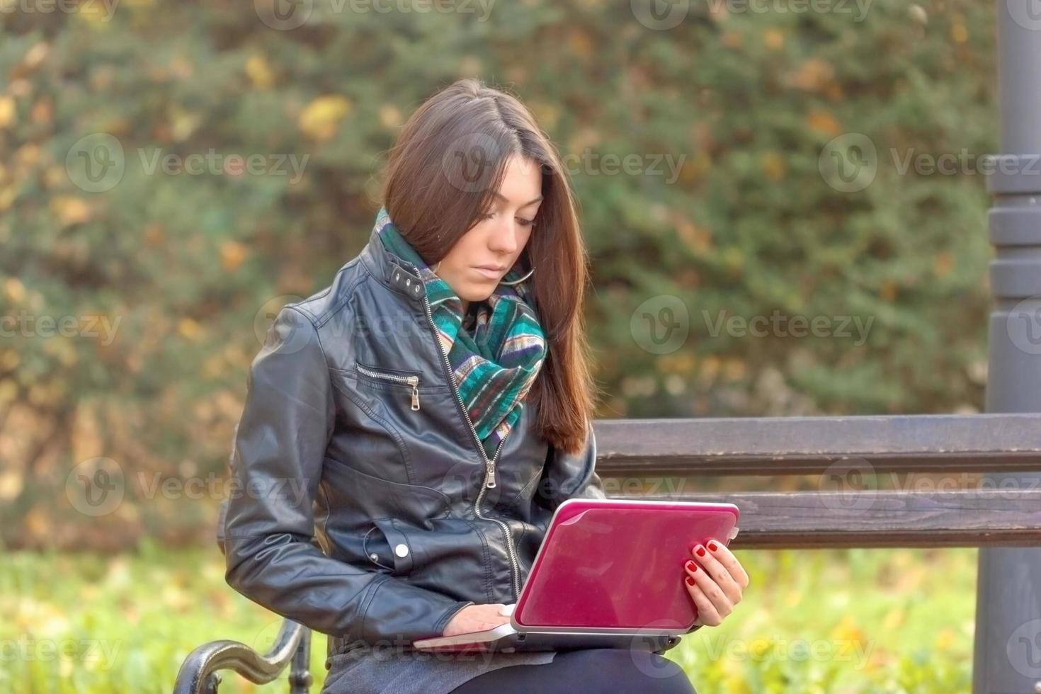 Srtudent use a laptop - learning otdoors photo