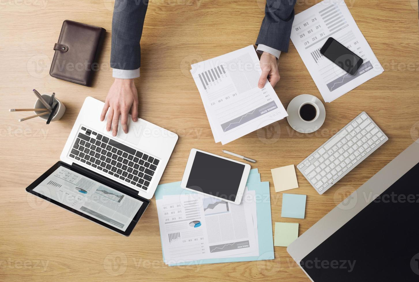 Businessman at work checking financial reports photo