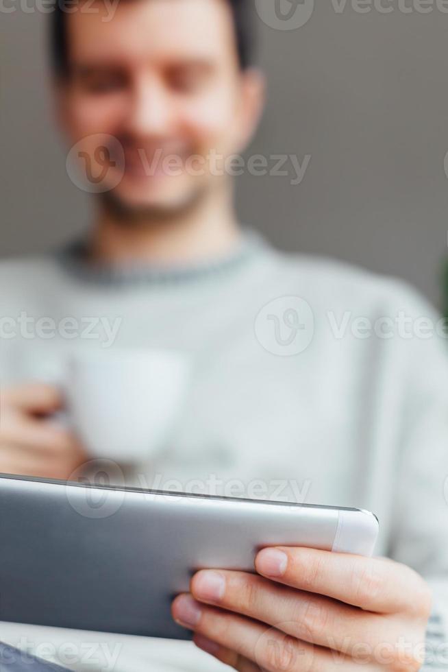 Happy man using tablet photo