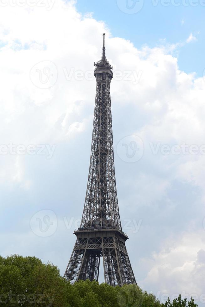 Eiffel Tower against the clouds photo