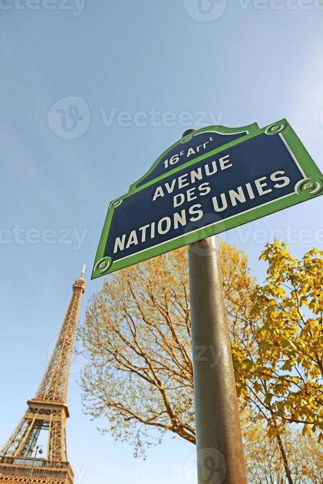 Eiffel Tower with street sign in foreground photo