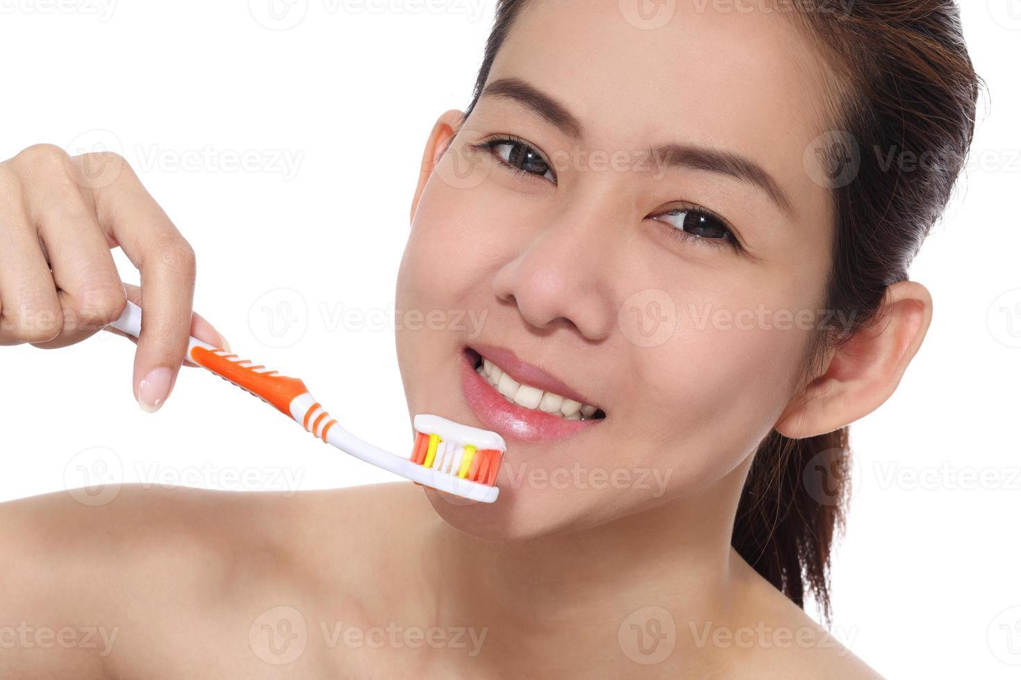 Asian girl brushing photo