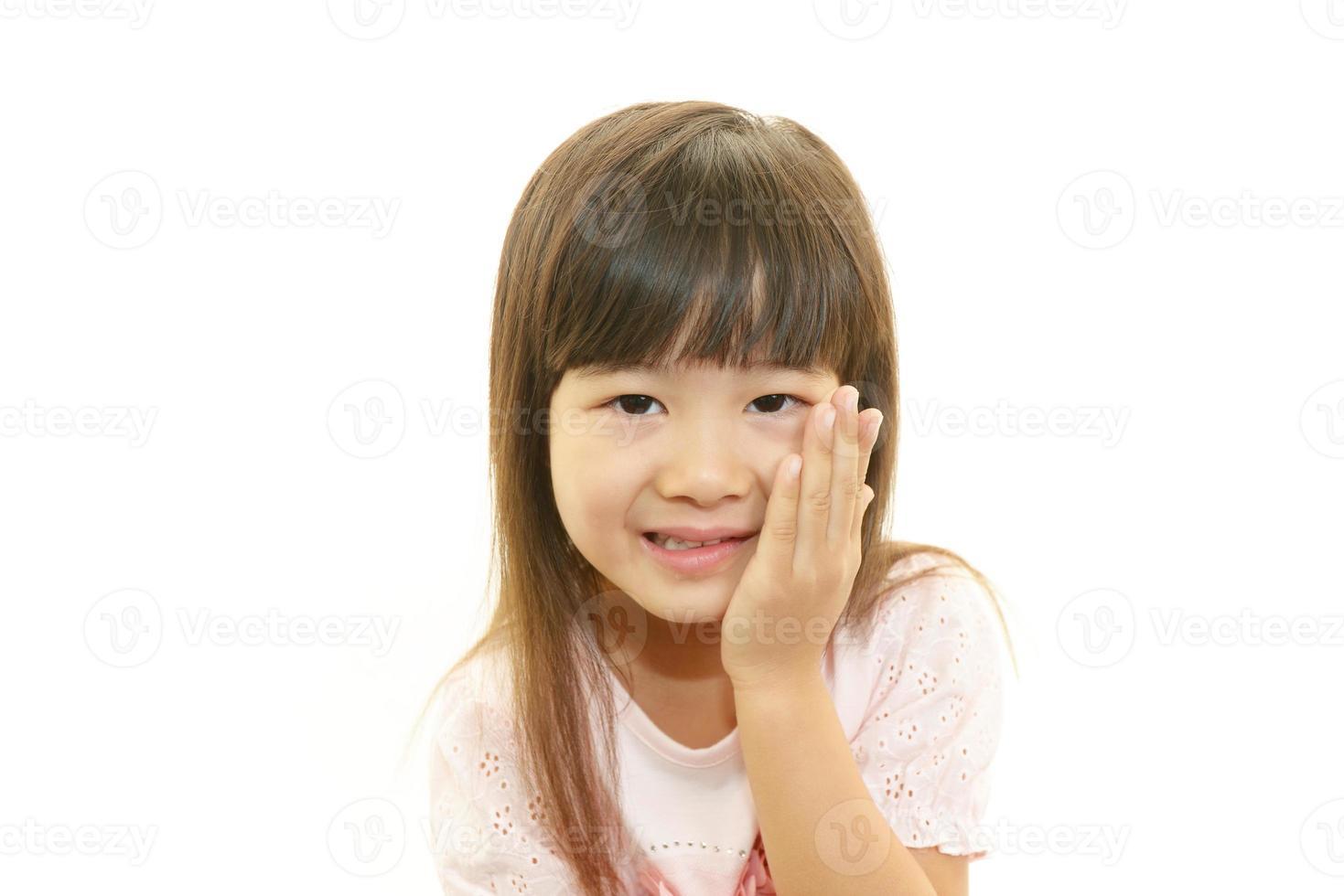 niña asiática sonriente foto