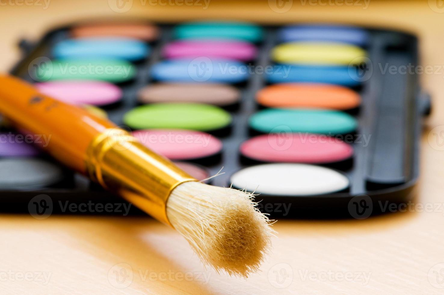 Art concept with painters palette and paint brush photo