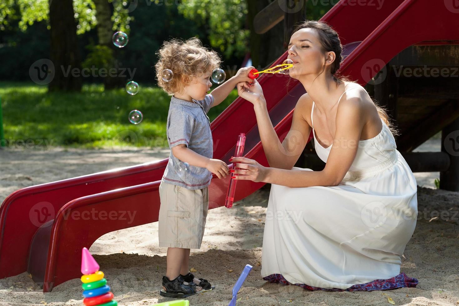 Mom and boy making bubbles photo