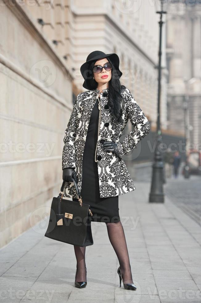 Attractive young woman in urban winter fashion shot photo