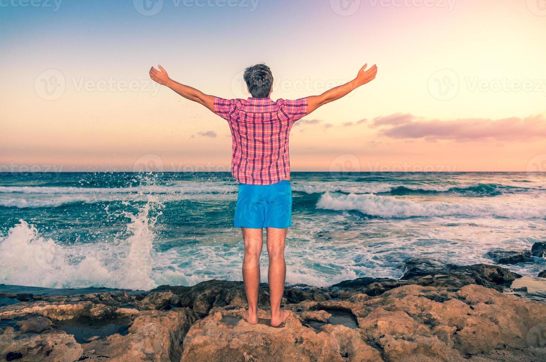 Happy man enjoying freedom outdoors photo