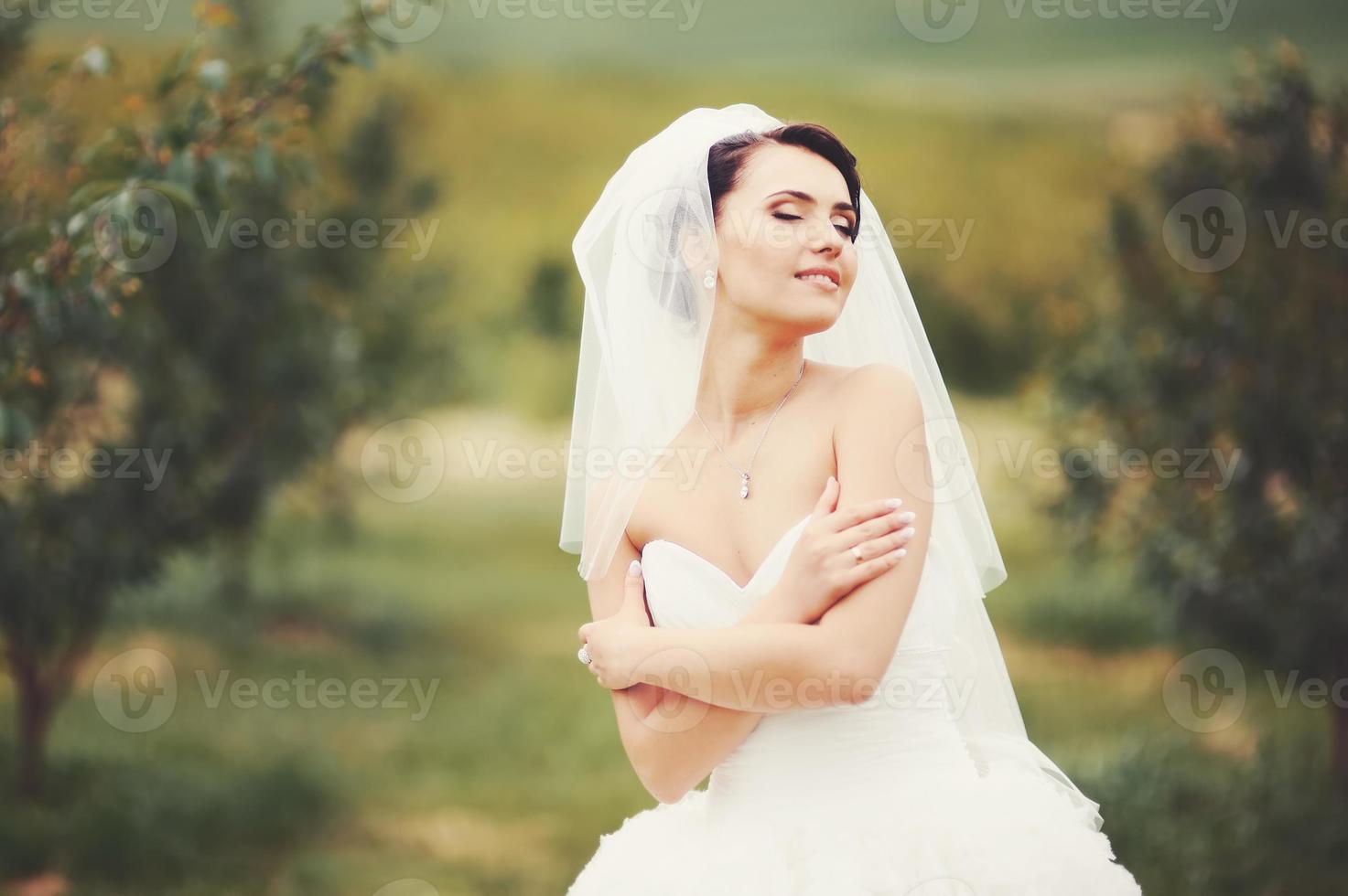 Gorgeous  young bride enjoying wedding day. photo