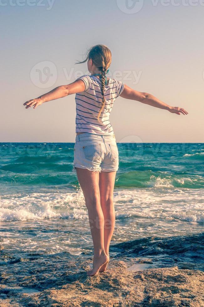 Girl enjoying nature on the beach photo