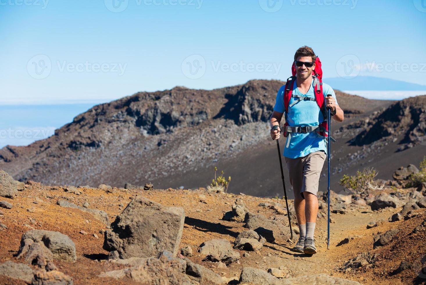 Hiker enjoying walk on amazing mountain trail photo