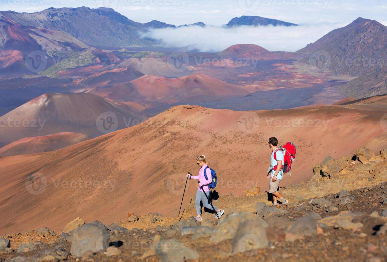 Hikers enjoying walk on amazing mountain trail photo
