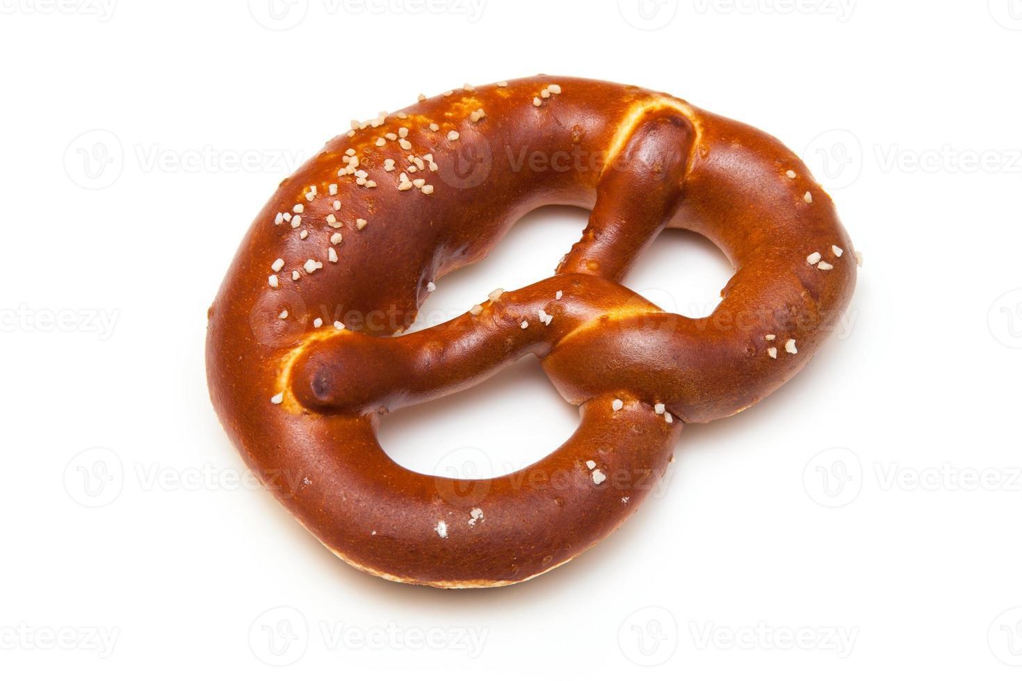 Rock salt pretzel isolated on a white studio background. photo