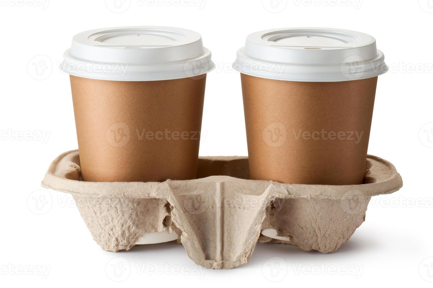 dois café para viagem no suporte foto