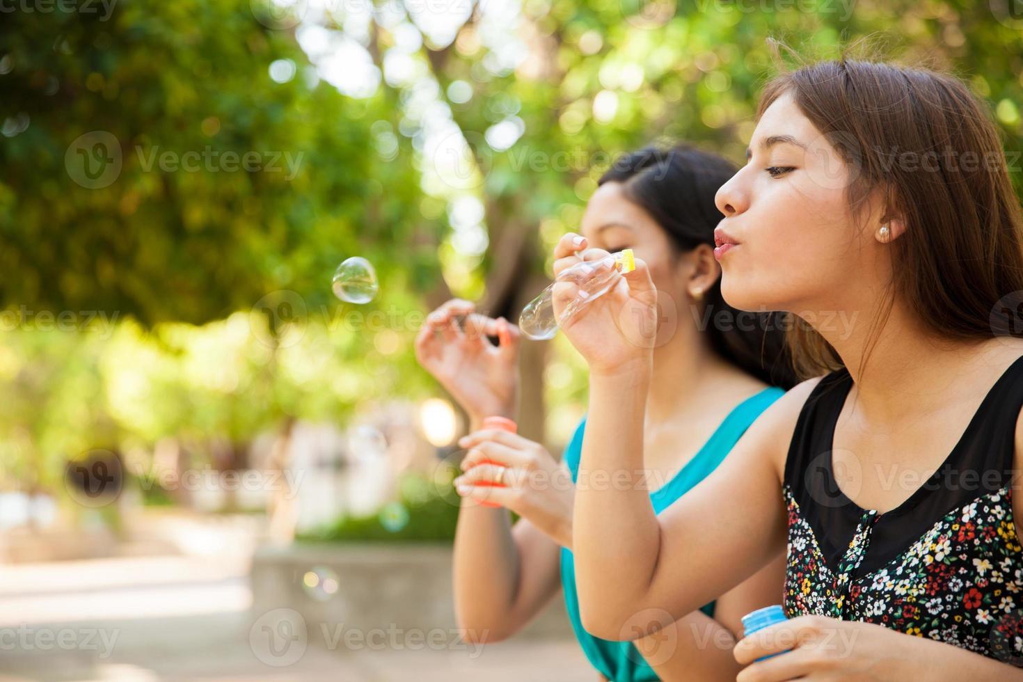 Blowing bubbles at a park photo