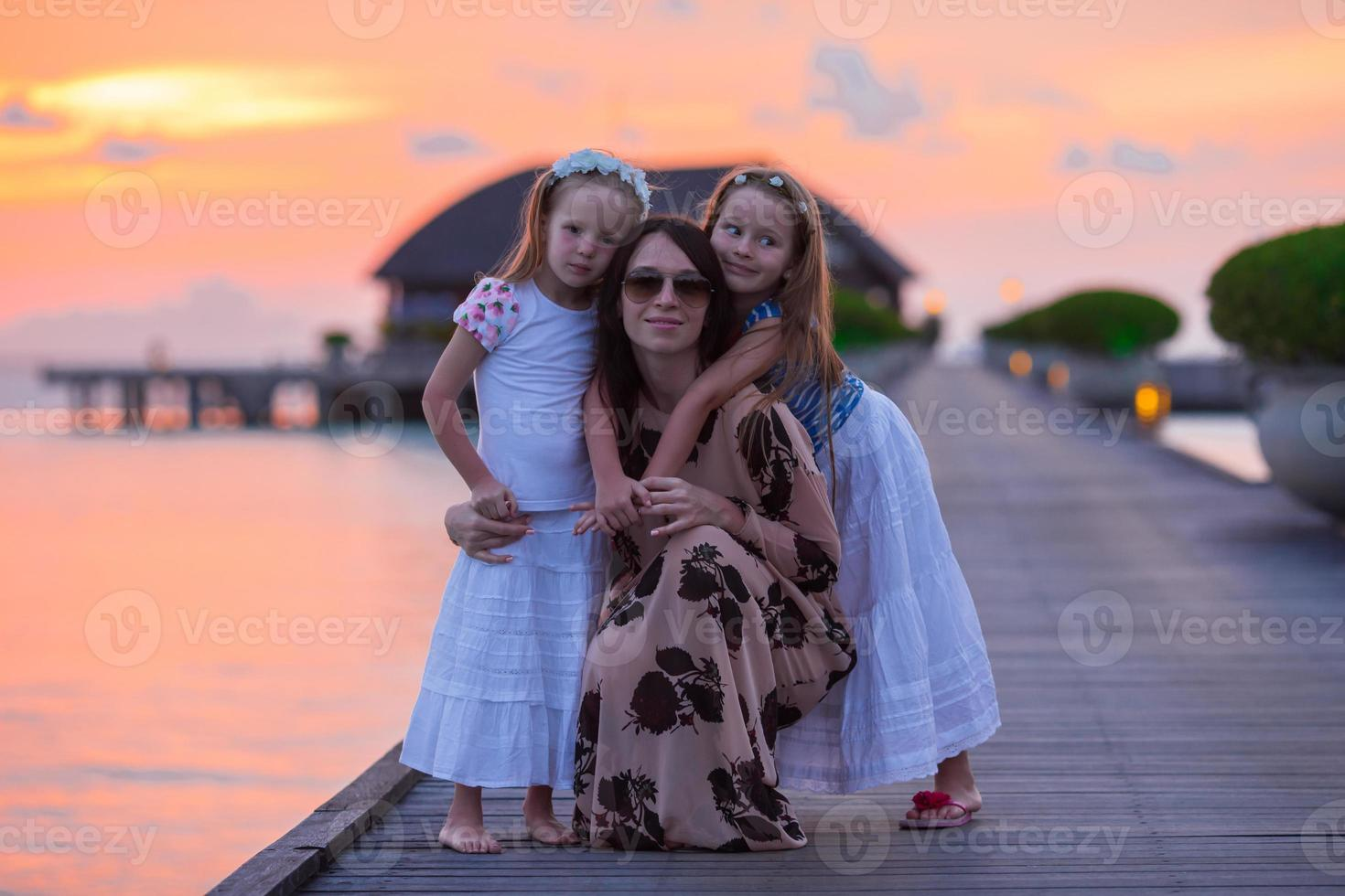 Young mother and two her kids at exotic resort photo
