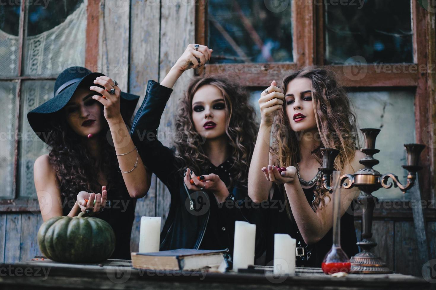 Three vintage witches perform magic ritual photo