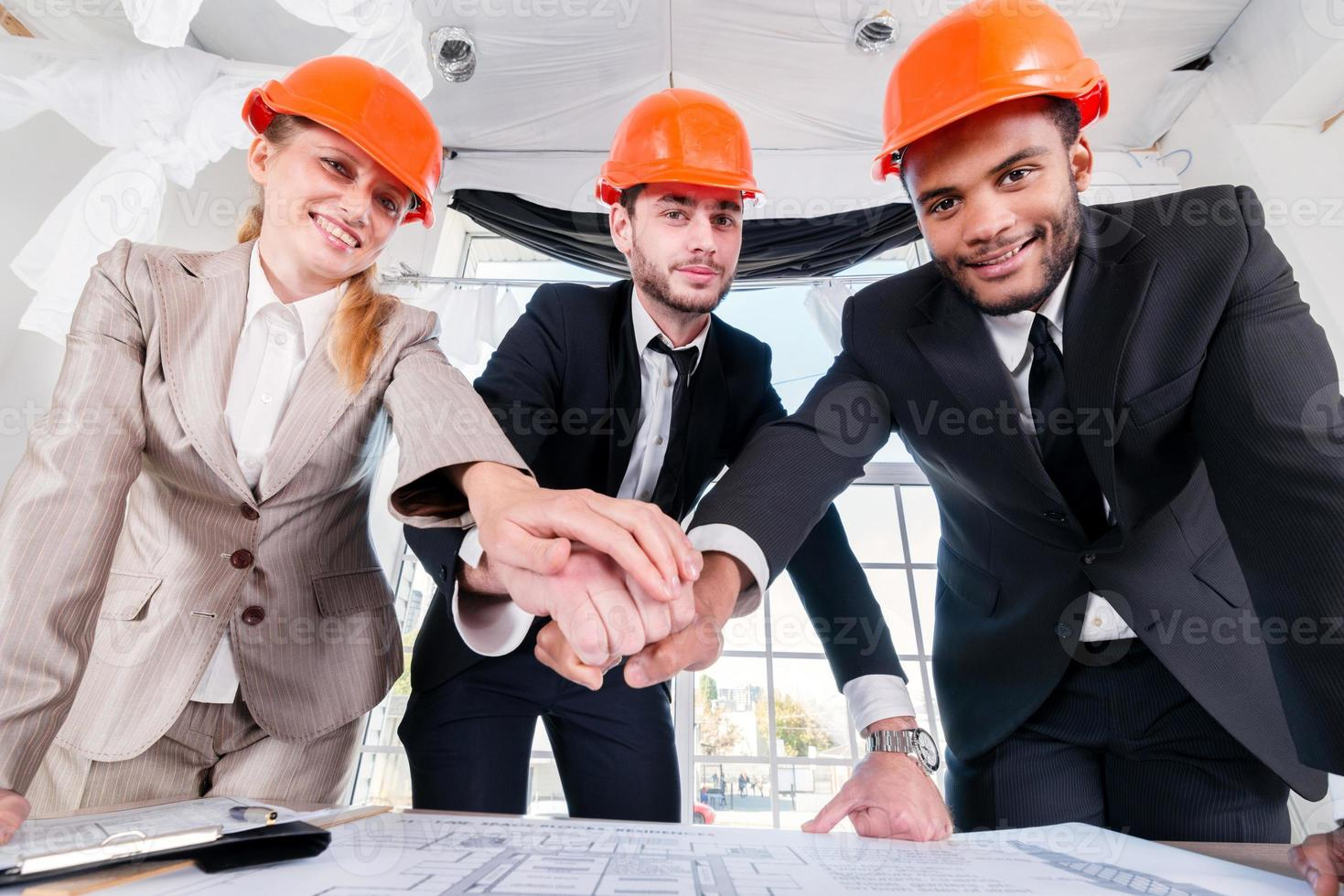 Architects laid hands on hands. Three businessmen architect met photo