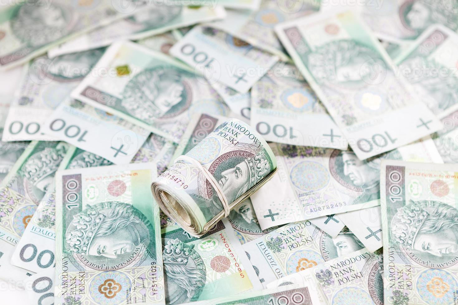 Wad of money on banknotes background photo