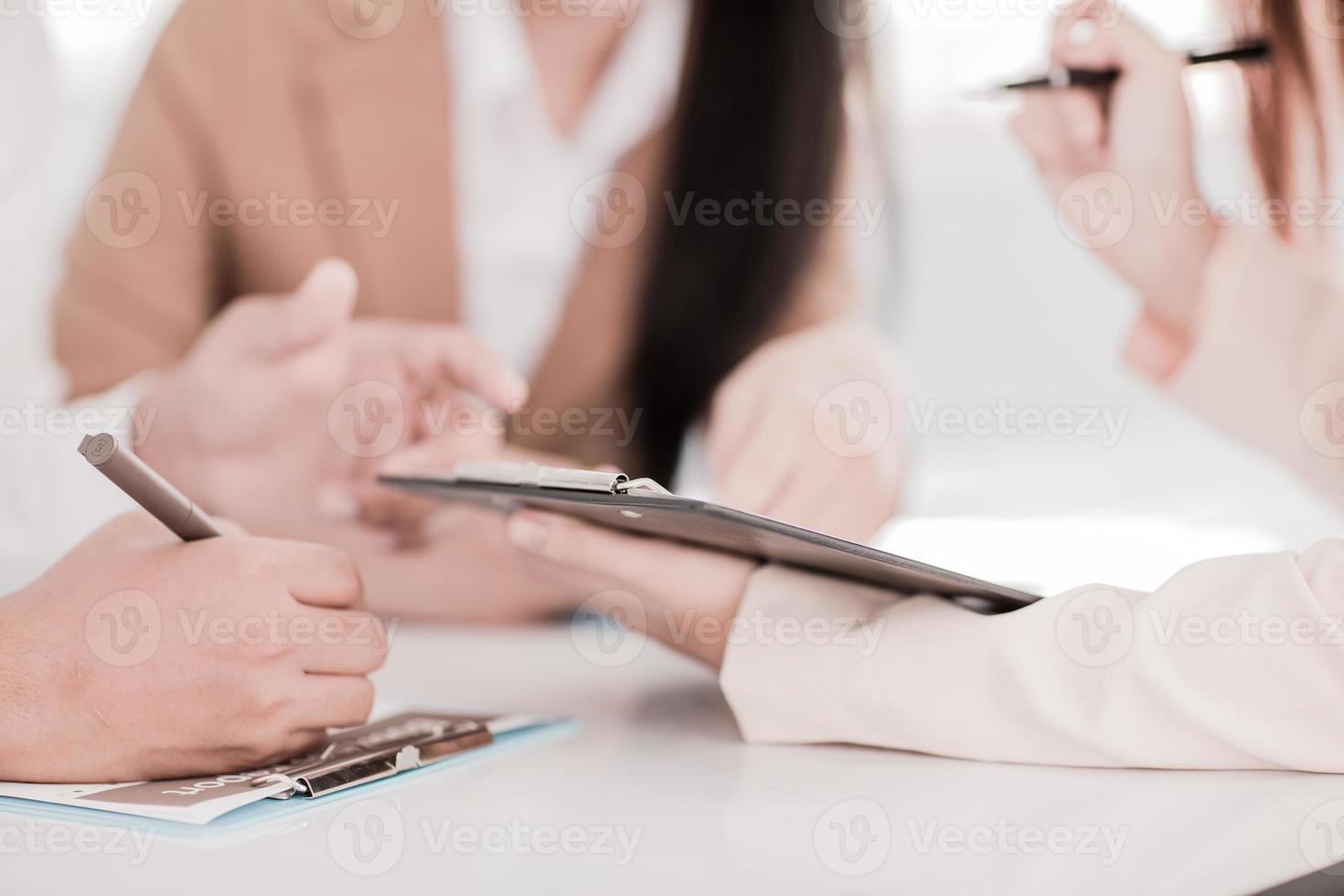 Business people discussing the charts and graphs showing the res photo