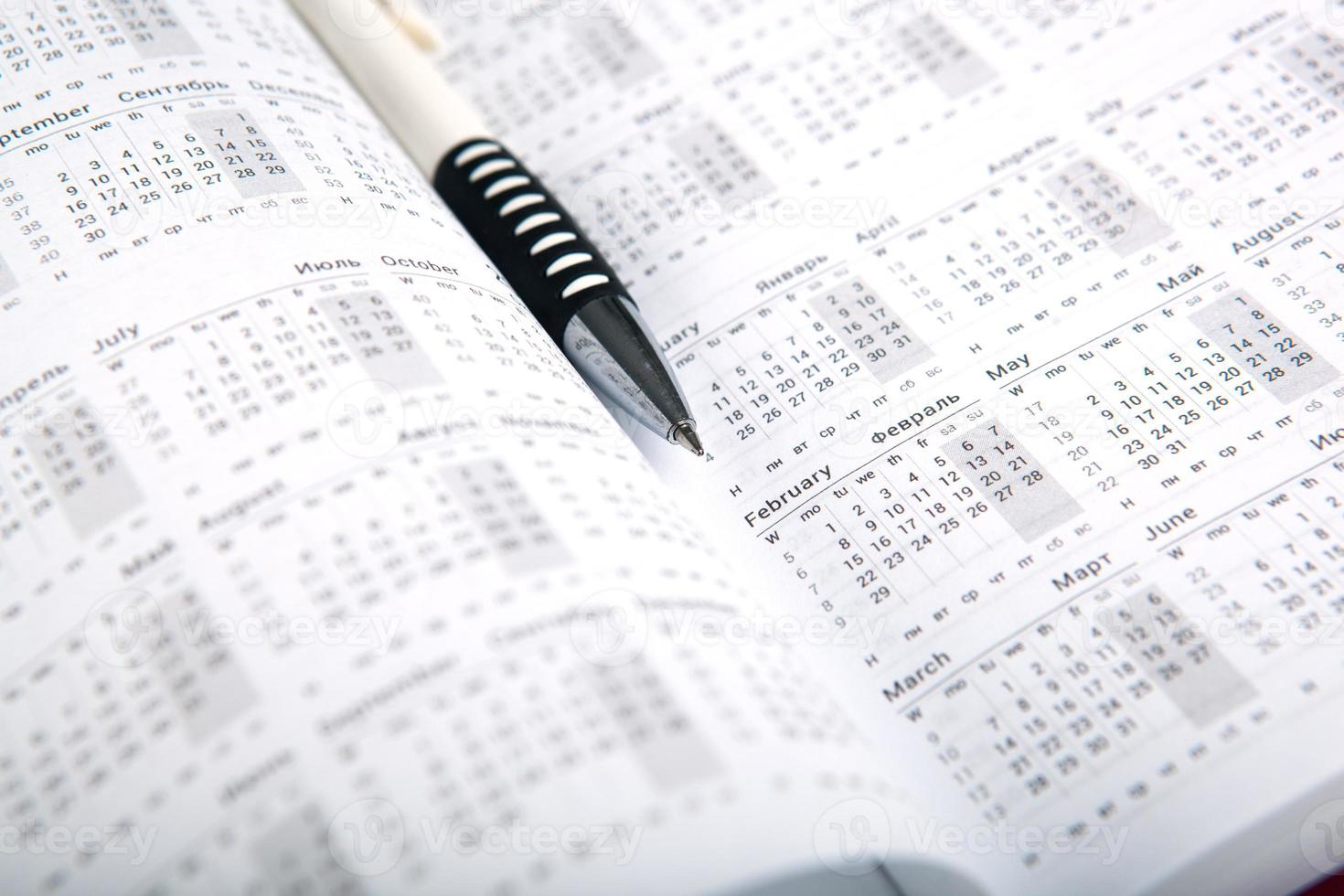 calendar days with numbers and pen photo