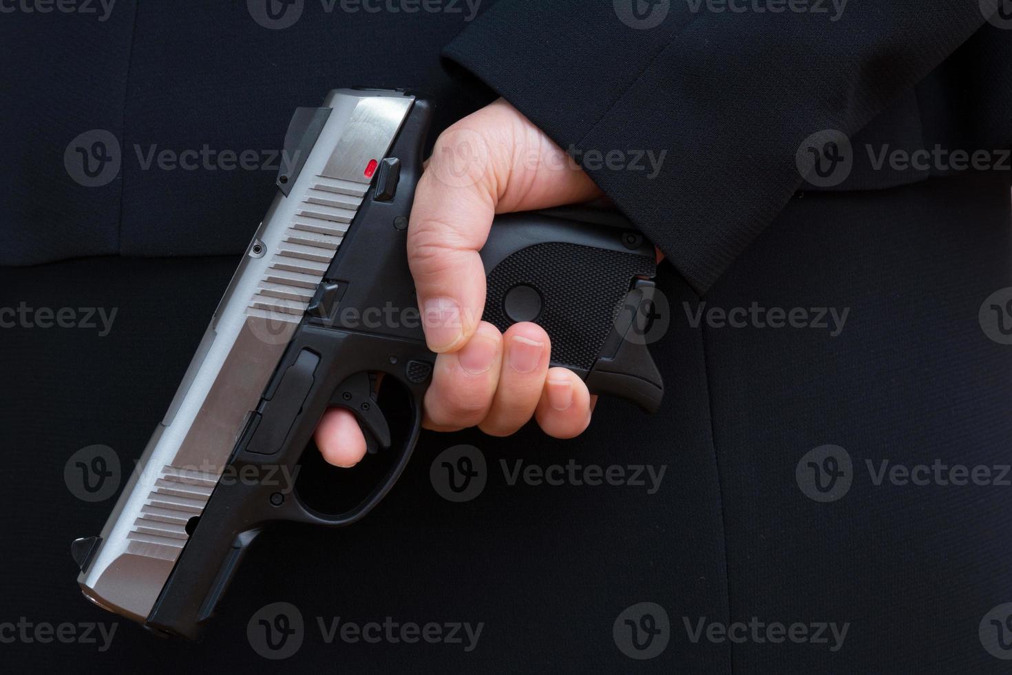 Woman holding a hand gun photo