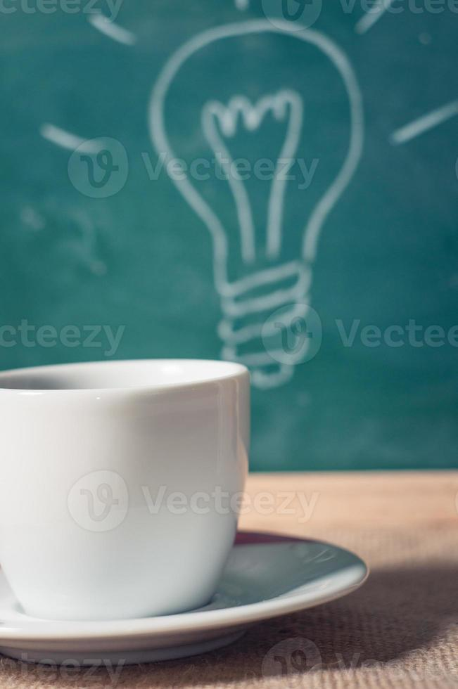 coffee cup and business idea on wooden table photo