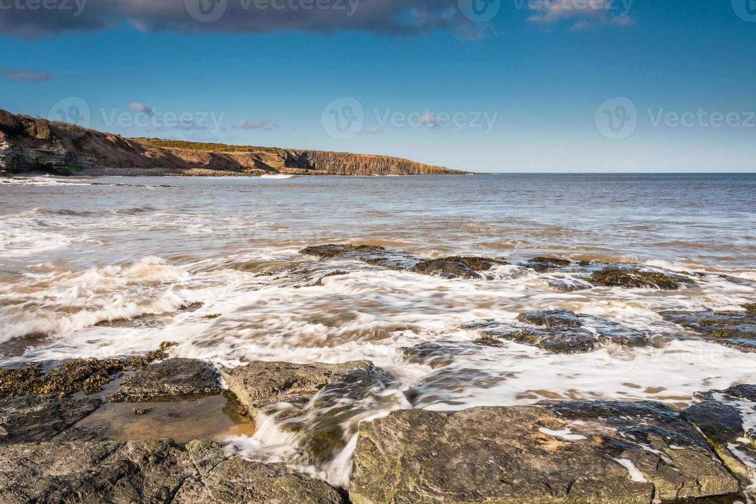 Incoming tide at Cullernose Point photo