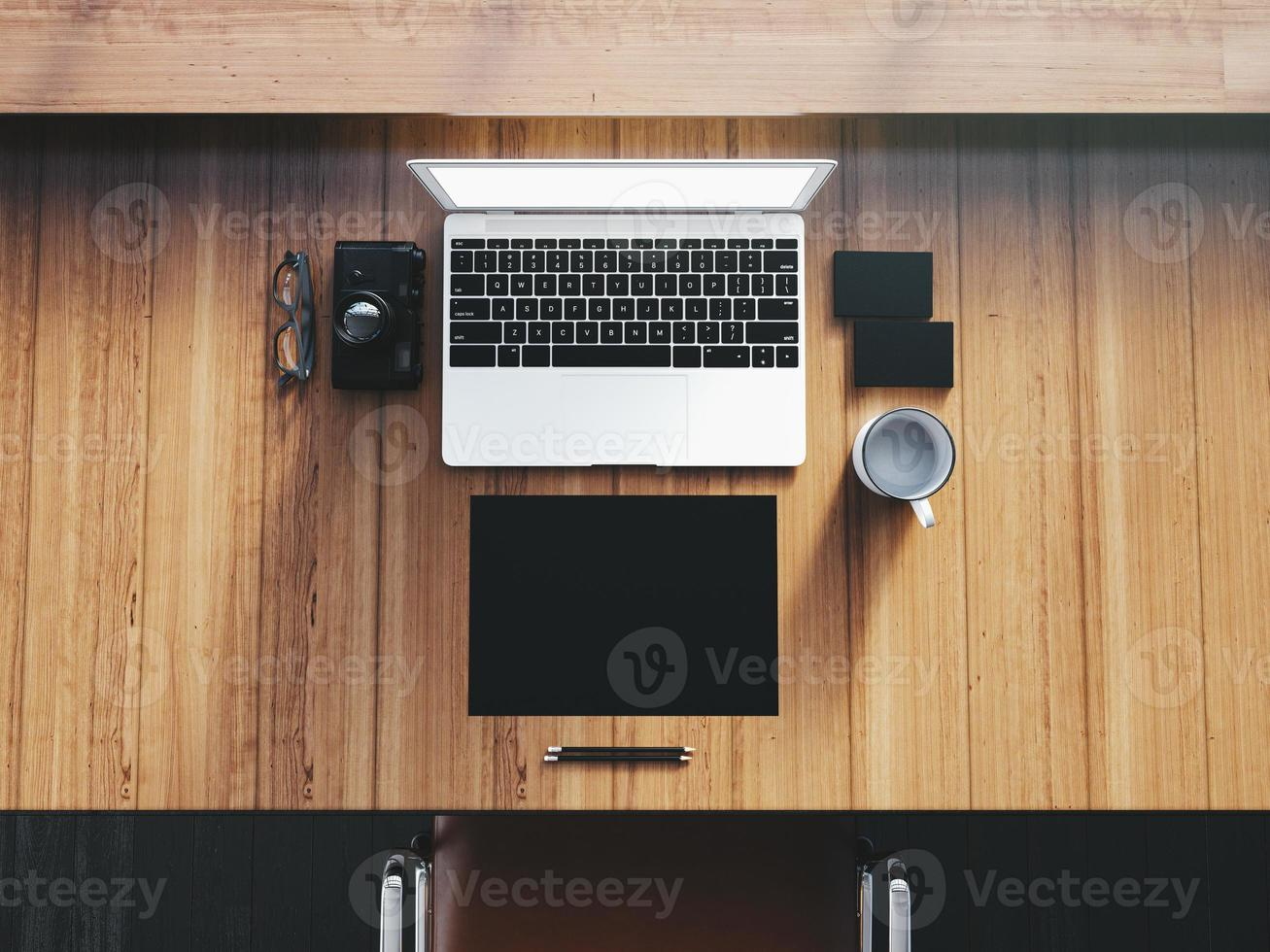 Generic design laptop on the workspace with business objects.  Top photo