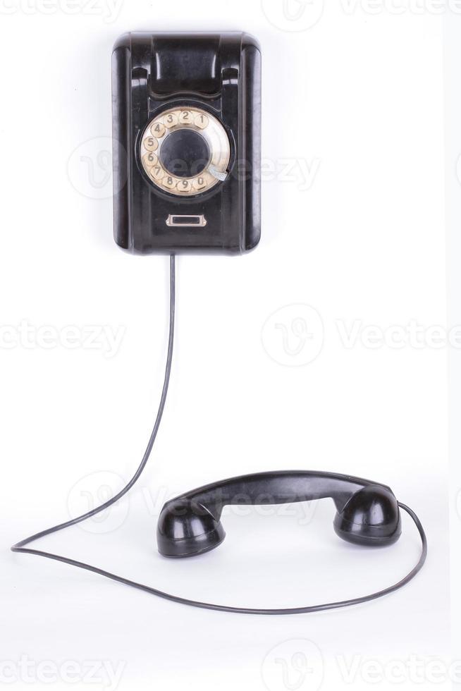 Old phone closeup isolated on white background photo