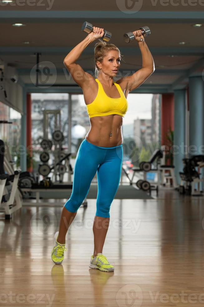 Mature Woman Exercising Shoulders With Dumbbells photo
