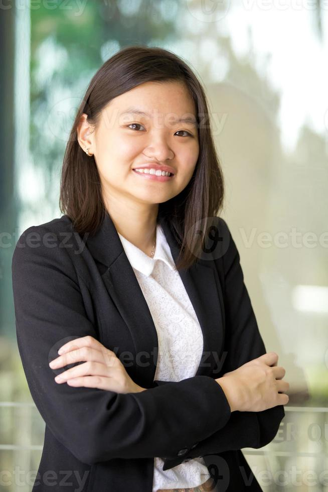 Young female Asian business executive smiling portrait photo