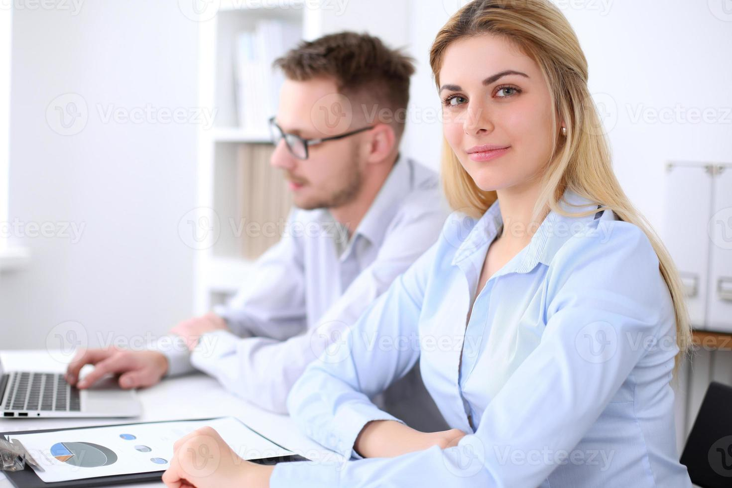 Two successful business partners working at meeting in office photo
