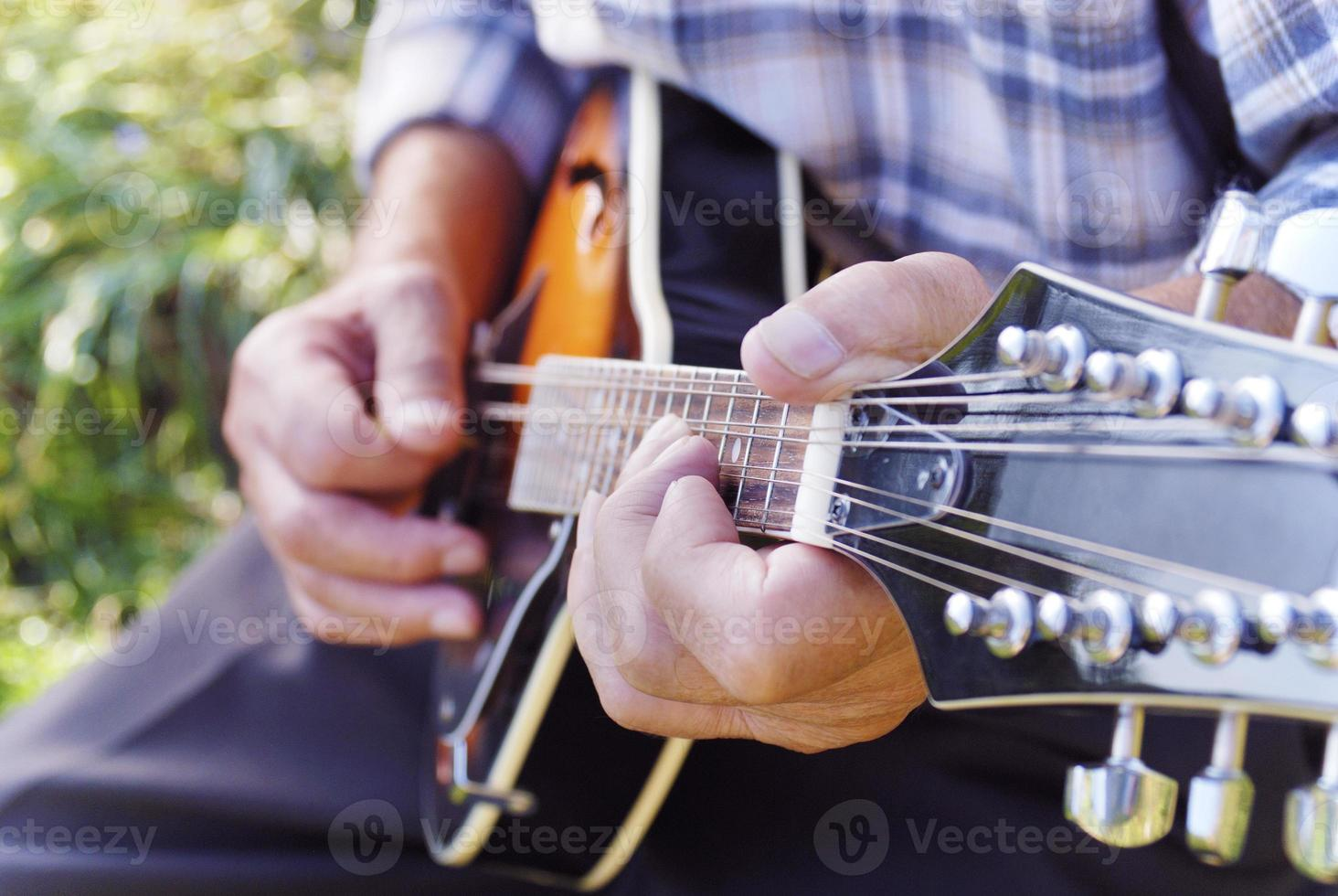 Senior man playing mandolin photo