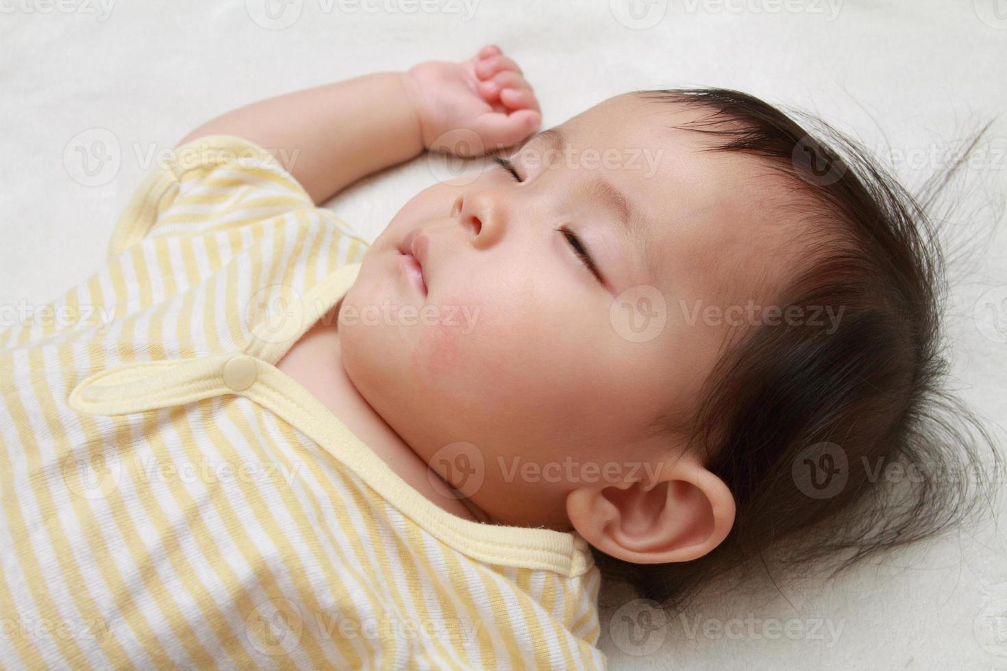 Sleeping Japanese baby girl photo