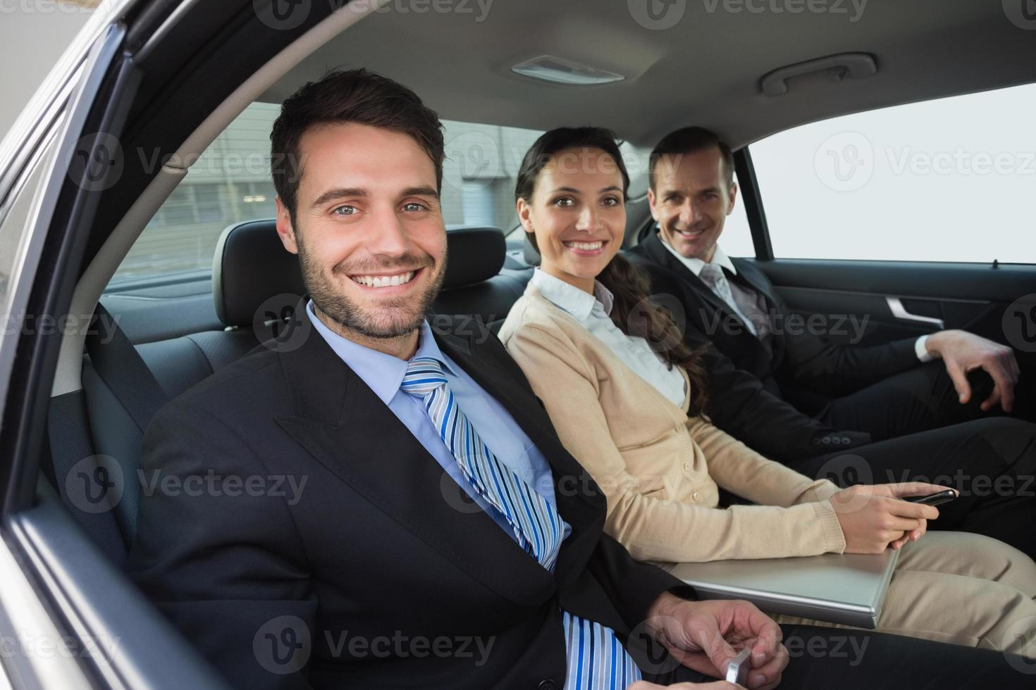 Business team working in the back seat photo