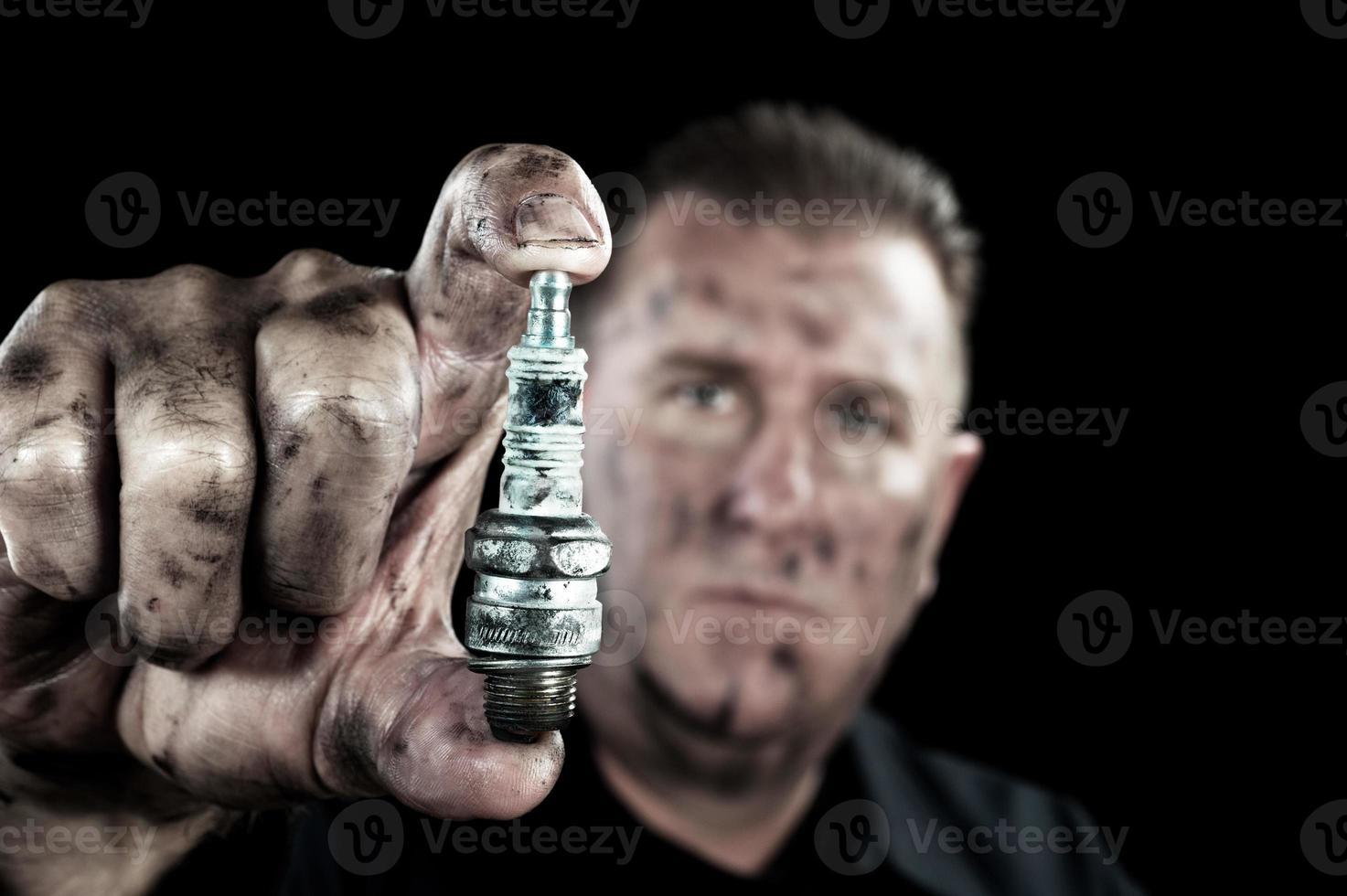 Auto mechanic and sparkplug photo
