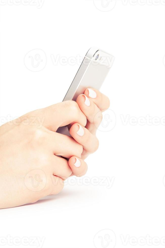 Hand holding White Smartphone with blank screen on white backgro photo