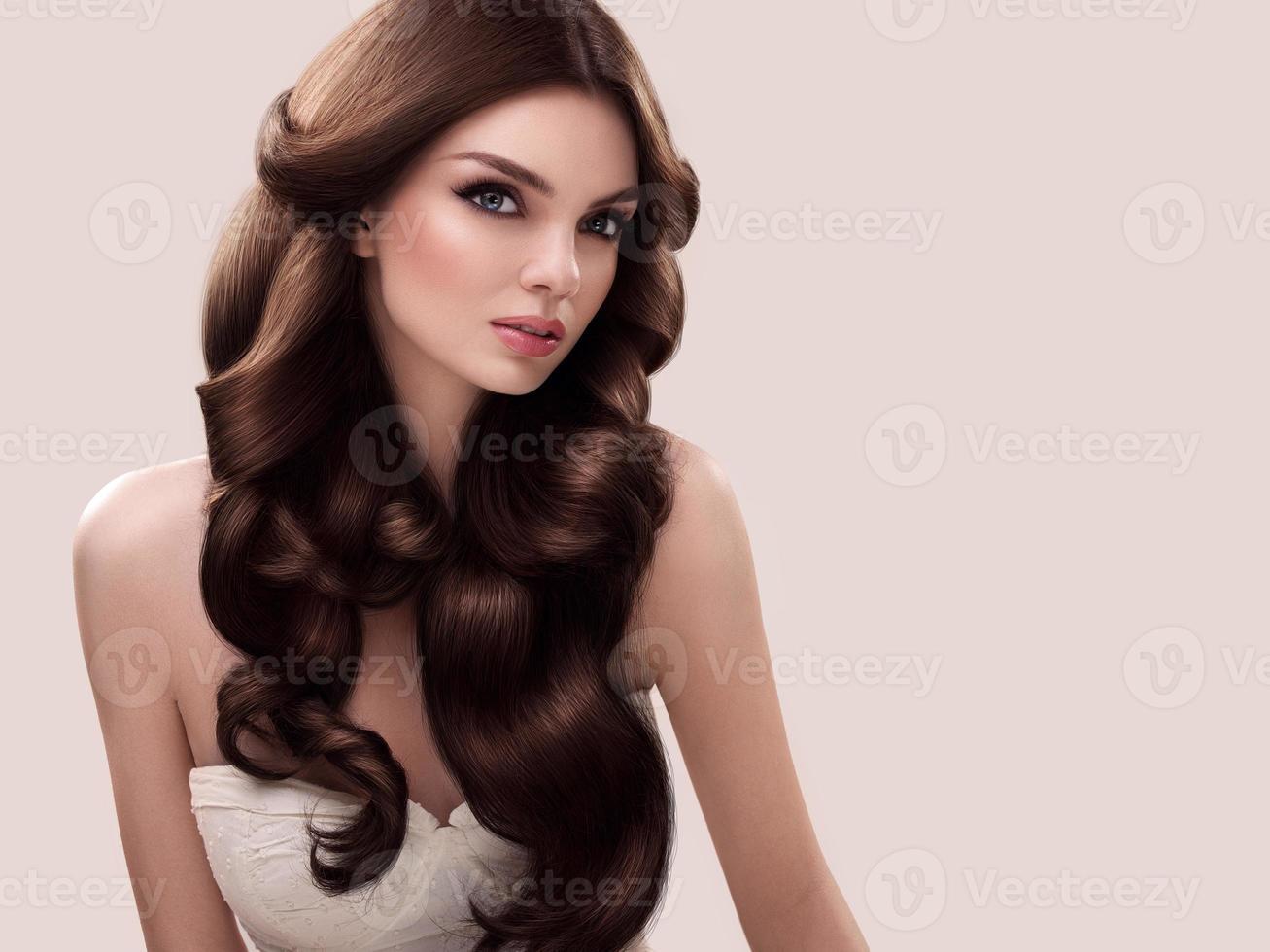 Hair. Portrait of Beautiful Woman's Long Wavy Hair. High quality photo