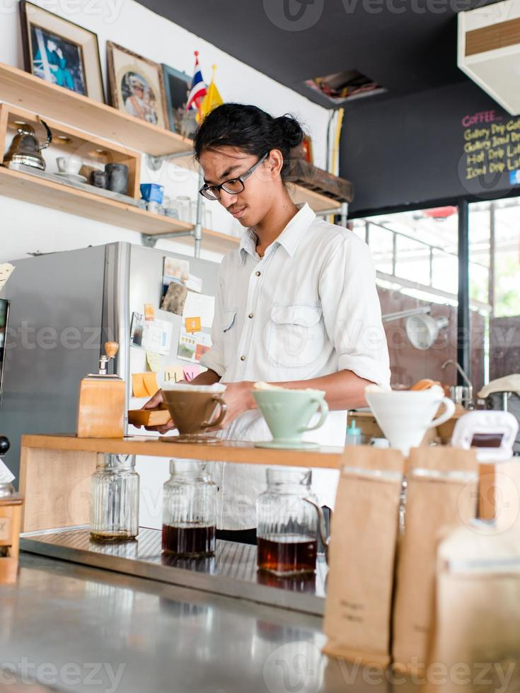 Barista brews single cup a coffee house photo