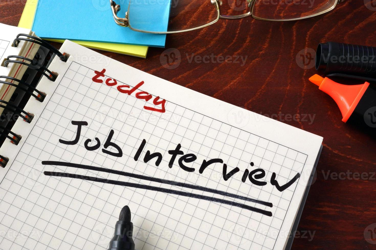 Notebook with Job interview  sign on a table. Business concept. photo