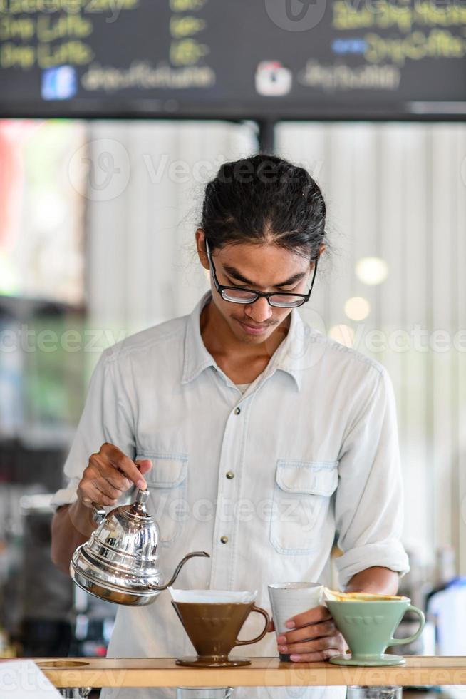 Barista brews single cup a coffee house photo