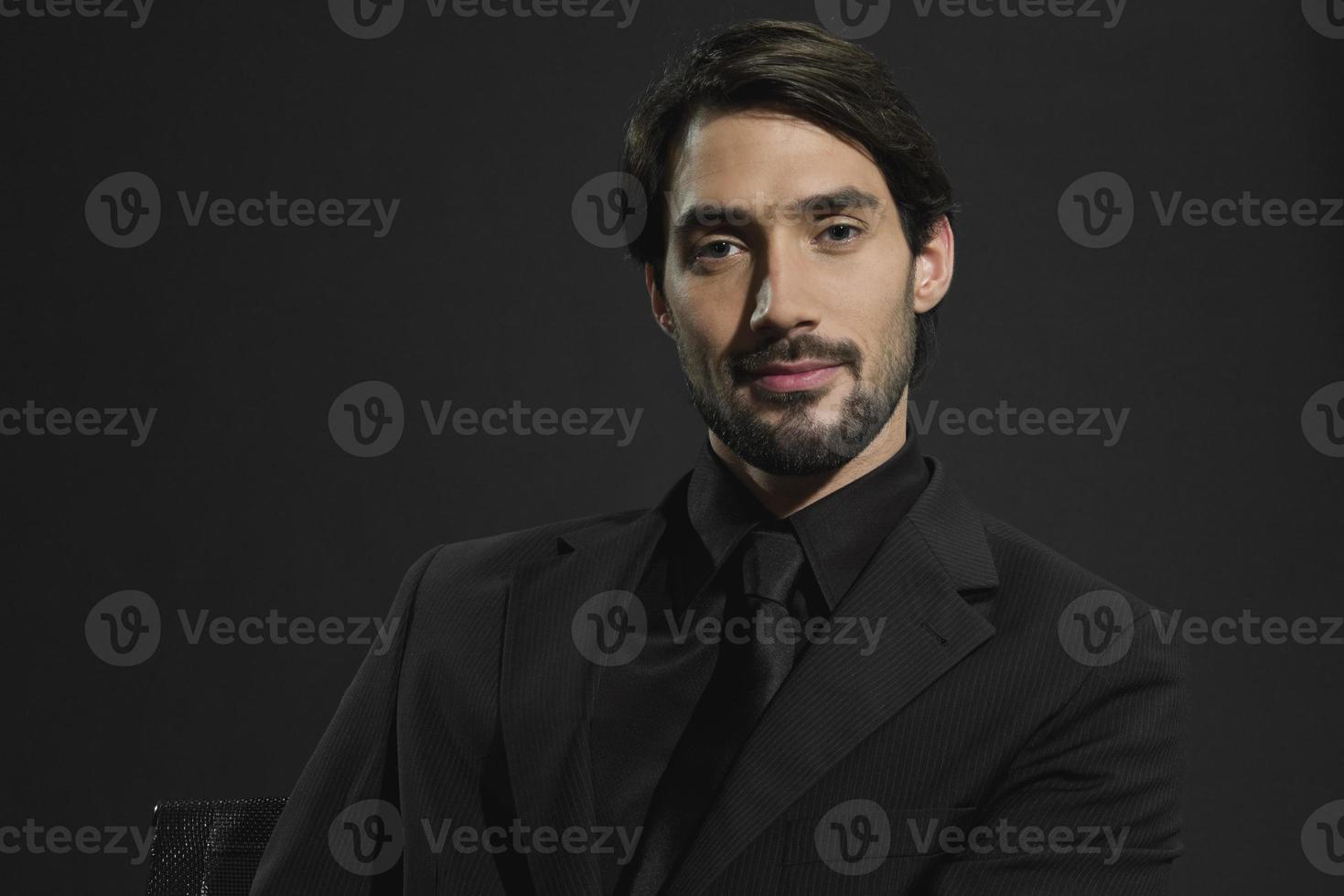 Portrait of young successful businessman photo