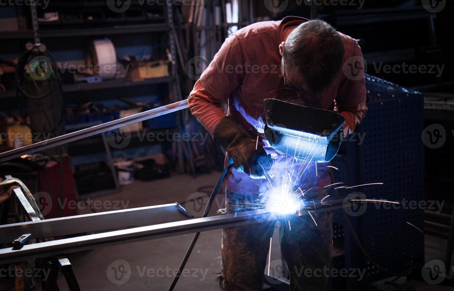 Employee welding steel photo